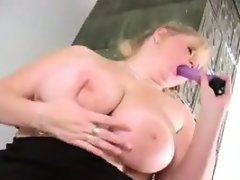 Big woman strips and masturbates with..