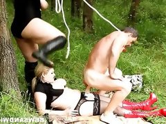 Two bbw punish a slave in the woods