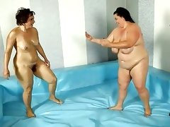 Hot nude fatties wrestle for referee\'s..