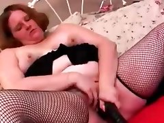 Sassy fatty in fishnets fucks a huge..