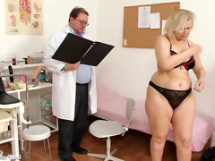 Gynecologist and his mature client in..