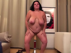 Fat belly babe rides dildo machine