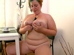 Fat girl fucks with long black dildo