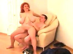 Fat redhead with saggy tits fucked on..